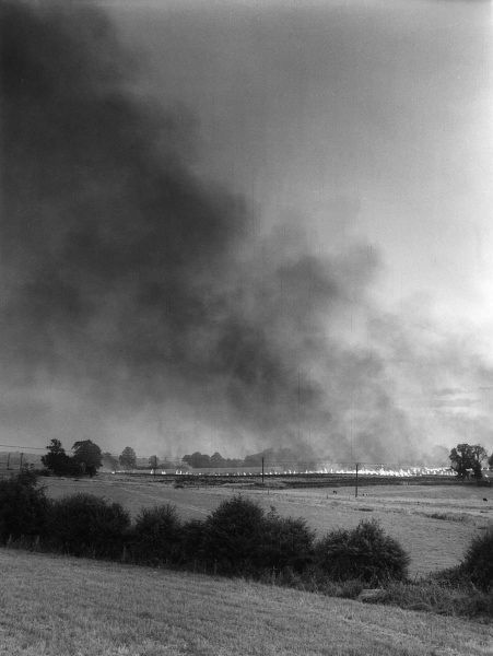 A wheat stubble fire, out of control, seen on farmland near Chapel Brampton, Northamptonshire, England. Date: 1960s