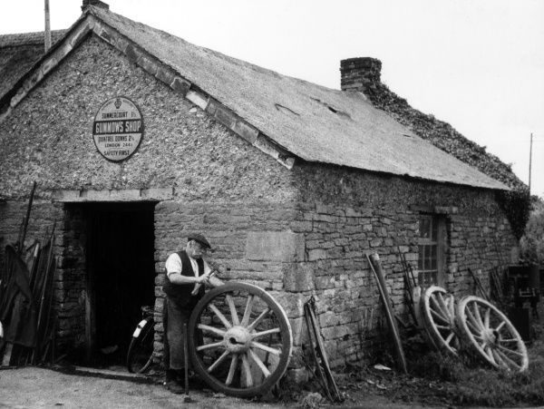 An old Wheelwright's barn in the hamlet with the strange name of 'Gummow's Shop', near Newquay, Cornwall, England. Who was 'Gummow' and what sort of shop was it? Date: 1930s