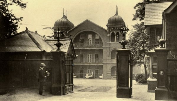 Entrance to Whipps Cross Hospital, Leytonstone, Essex. Several patients can be see in beds on the open balconies. The hospital was opened in 1903 by the West Ham Union for the sick poor in the area