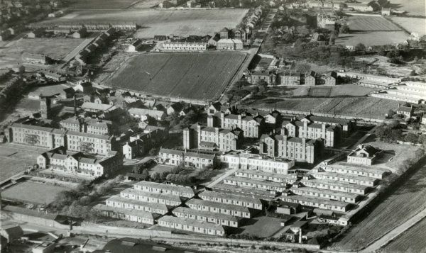 An aerial view of Whiston Hospital, Warrington Road, Whiston, Lancashire. The site began life in 1843 as the Prescot Union workhouse. The cross shaped building (left of centre) was the original workhouse