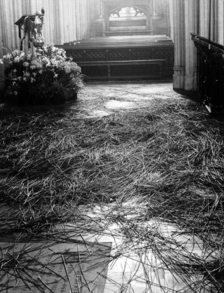 The Whit Sunday custom of strawing the floor of the Nave of the church with rushes, dating back to 1493. St. Mary Radcliffe Church, Bristol, England. Date: 1930s