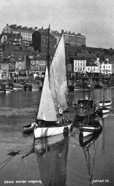 Whitby Harbour, North Yorkshire, with boats. Date: 1940s