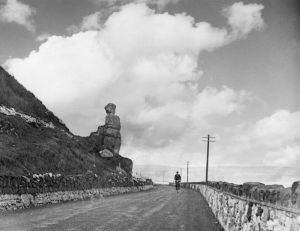 'White Lady Rocks', a well- known landmark on the Antrim coastal road, County Antrim, Northern Ireland. Date: 1930s