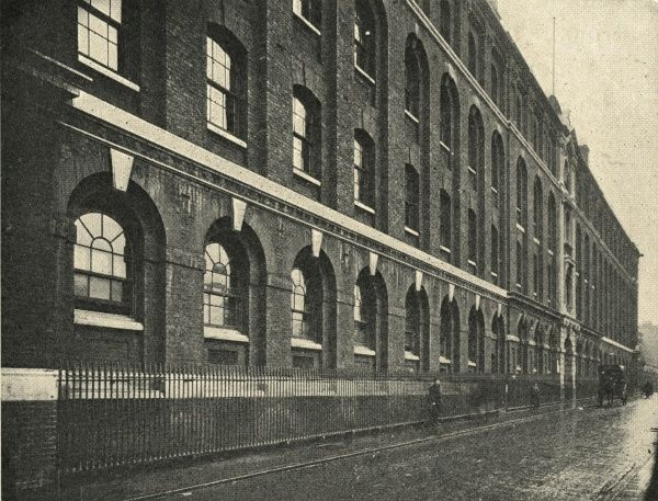 Exterior view of the Whitechapel Workhouse Infirmary on Charles Street (later Baker's Row, now Vallance Road), East London. A carriage stands outside the entrance