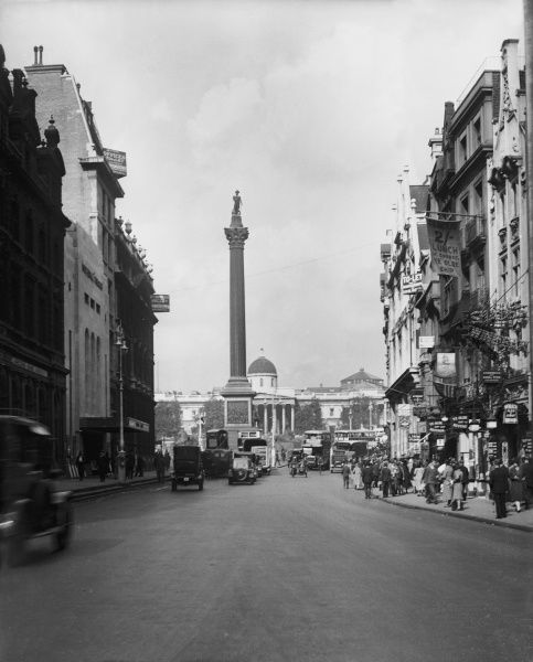 Looking up Whitehall towards Trafalgar Square, with Nelson's Column and the National Gallery in the distance, London