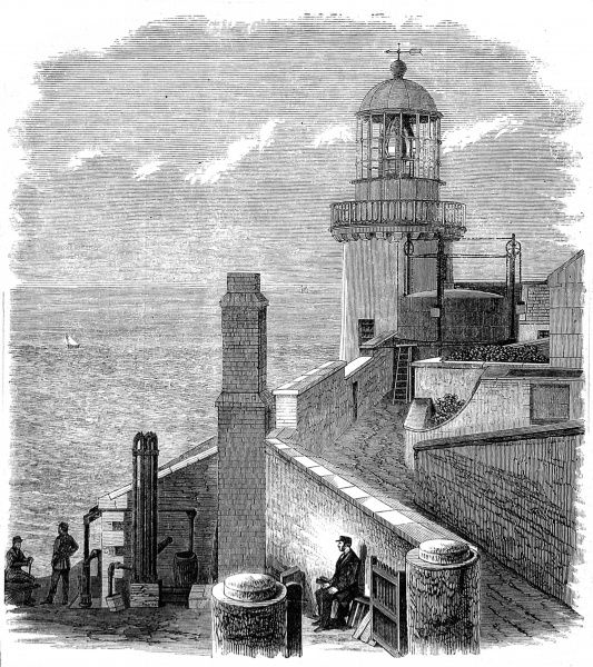 Engraving of the Wicklow Head Lighthouse, 1869. The lighthouse lantern was converted from oil to gas in 1868, which required a small gas works at the lighthouse (seen in the foreground)