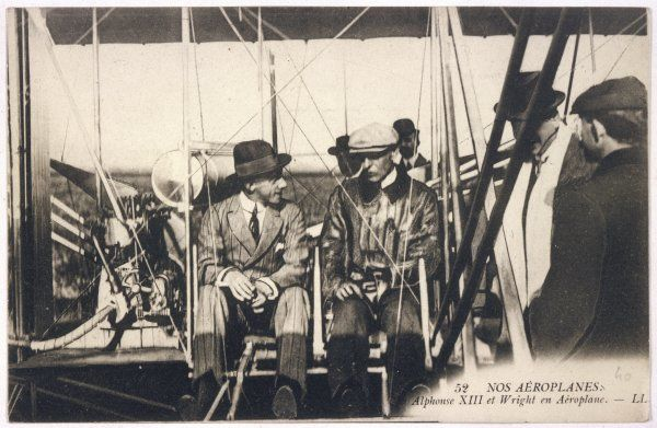Wilbur Wright shows his plane to Alfonso XIII of Spain at the Ecole d'Aviation, Pau, France, but the king is not allowed to risk his life in an actual flight