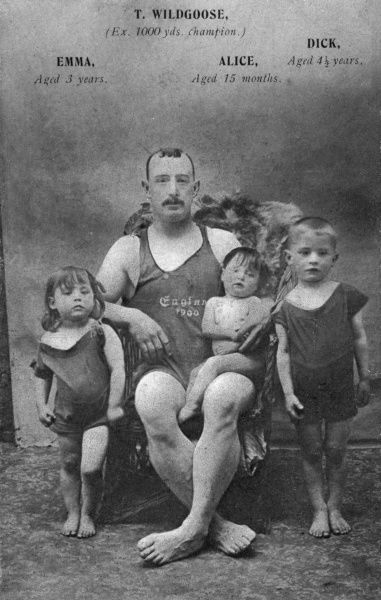 A family of swimmers, all in their swimming costumes: T Wildgoose, ex-1000 yards champion, with Emma (3), Alice (15 months) and Dick (4). Date: 1910s
