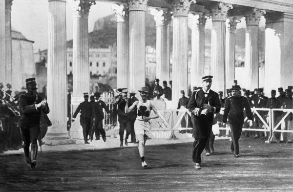 William D. Billy Sherring (1878-1964) wins the marathon race at the 1906 Summer Olympics. Prince George of Greece is running the last 50 metres alongside Sherring. Date: 1906