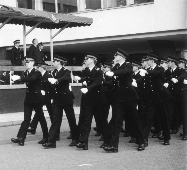 William Whitelaw (1918-1999), Conservative politician, with police commissioners observing a march past during a parade of Metropolitan Police cadets