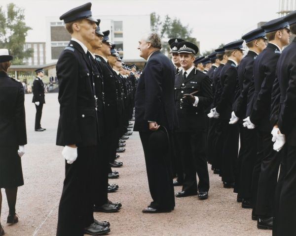 William Whitelaw (1918-1999), Conservative politician, with police commissioners, inspecting Metropolitan Police cadets during a parade