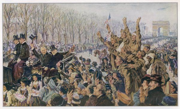 Woodrow Wilson, American President, drives through the streets of Paris - he is acclaimed by Americans in the crowd along the Champs Elysees