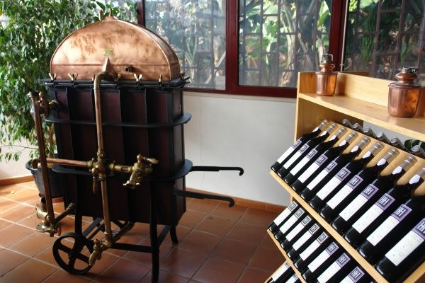 An antique object used in the making of wine, in the showroom of Henriques & Henriques SA, Camara de Lobos, near Funchal, Madeira, Portugal