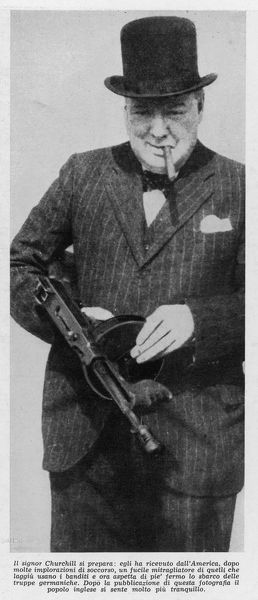 Winston Churchill (1874-1965) holding tommy gun while visiting America