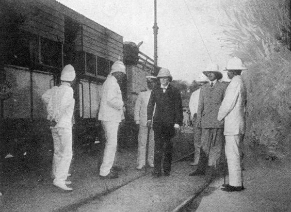 As under-secretary for the colonies, Winston Churchill arrives at Mombasa on his tour of Africa. Here, he is welcomed by the Governor of the East African Protectorate(wearing the spiked helmet)