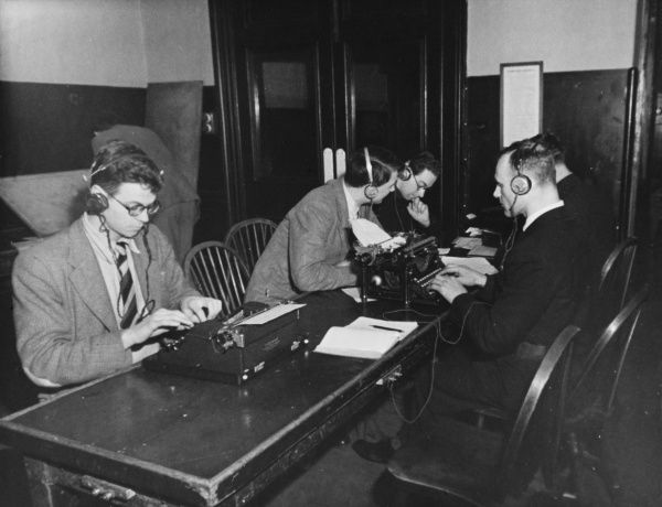 Wireless Operator School, during World War II. Advanced students receiving and typing messages simultaneously