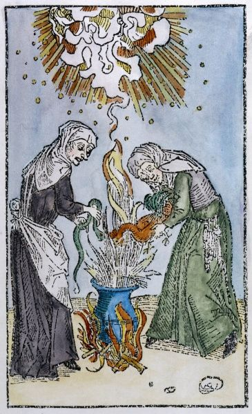Two witches prepare a magic brew, adding a snake to add a little venom, and a cock to give it flavour