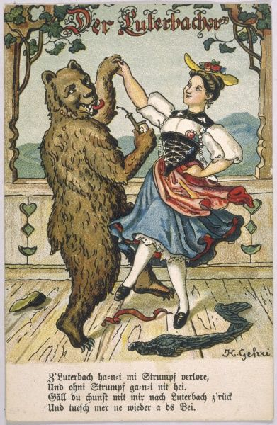 Young woman in peasant costume dances with a lascivious- looking bear