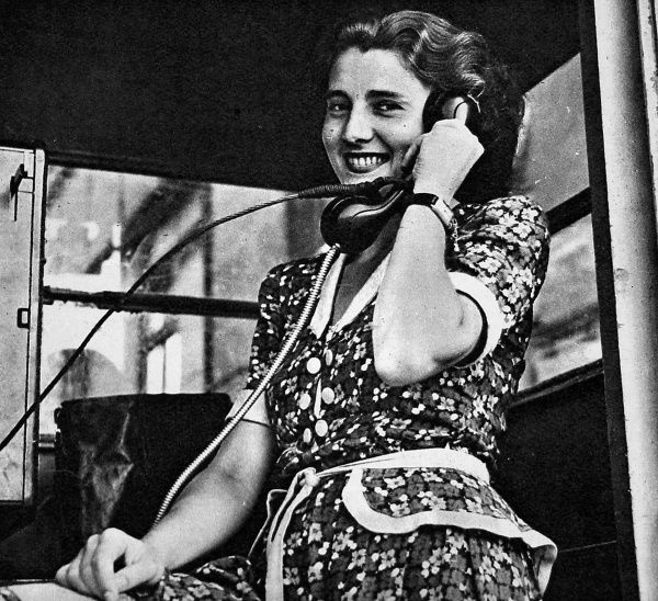 Photograph showing a female citizen of West Berlin making a call from a public telephone box, August 1948