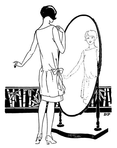 A young woman checks her dress in a large oval mirror