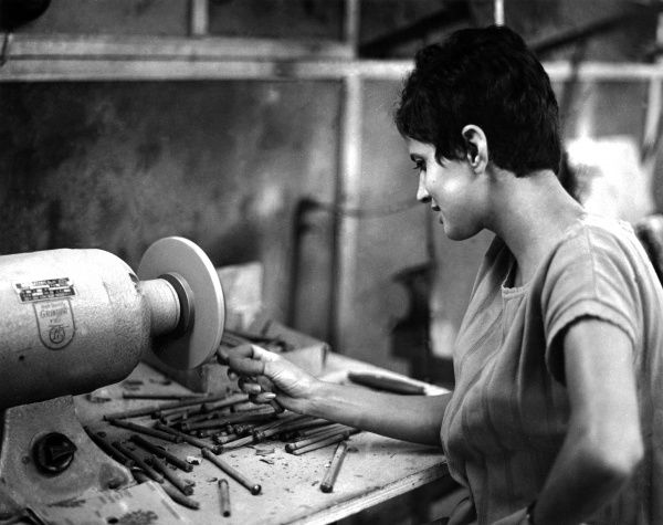A woman working Eilat stone, Israel. Date: 1960s