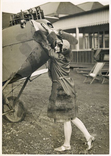 As flying becomes a popular pastime, more women participate : at Stag Lane aerodrome, London, a pupil learns how to swing the propeller without accident