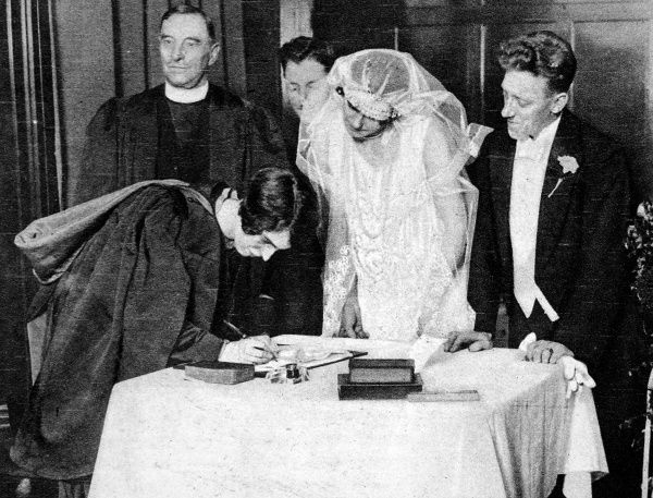 The Reverend Miss Vera Findlay, Minister at the Stewartville Congregational Church, Partick, Glasgow, signing the register after having conducted a marriage ceremony in Scotland