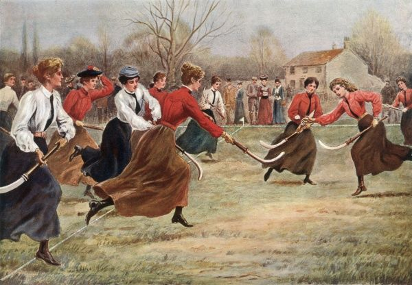 A women's hockey match -- they are wearing long skirts, which must be rather difficult to run in