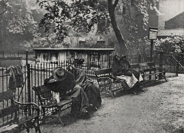 A group of women vagrants sleeping on benches at the churchyard of Christ Church, Spitalfields, East London