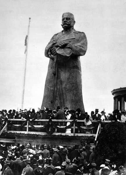 A big wooden statue of Field-Marshal von Hindenburg erected in Berlin. It was proposed that Germans could drive nails into the statue for a fee, with proceeds to go to charity