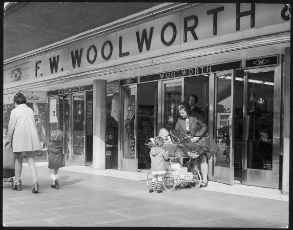 Women and children outside Woolworth's in Crawley, Sussex, England