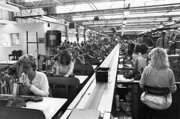 Rows of women working at sewing machines at Finn's Shoe Factory - Penzanze, Cornwall