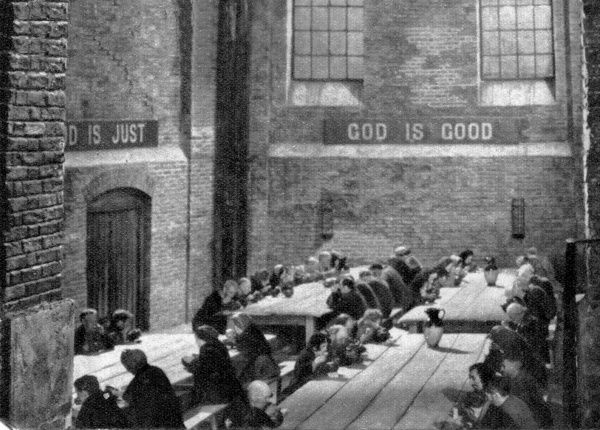 A workhouse dining hall interior, from the 1948 film of Oliver Twist, directed by David Lean. The religious mottos reminded the inmates that due gratitude was in order for the care they were receiving