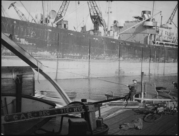 Loading grain into lighters at the King George V Dock in Hull, Yorkshire