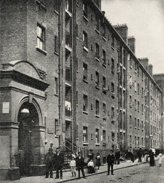 A block of working men's homes, near Middlesex Street, Spitalfields, East London. A number of organisations such as the Peabody Donation Fund and the Improved Industrial Dwellings Company erected low-cost flats of this type for working men