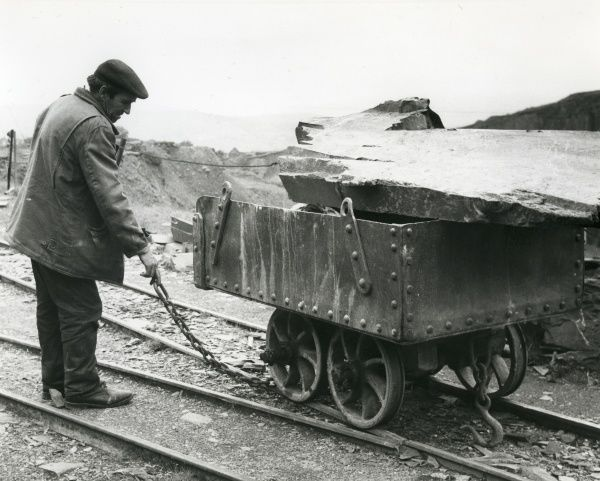 A workman with a slate quarry tram, somewhere in North Wales