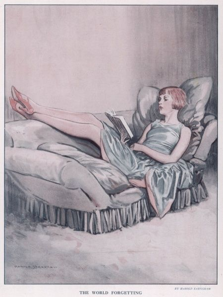 Lady reclining on a settee reading a book