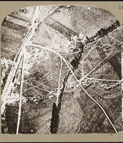 An aerial photograph of dry trenches and shell craters