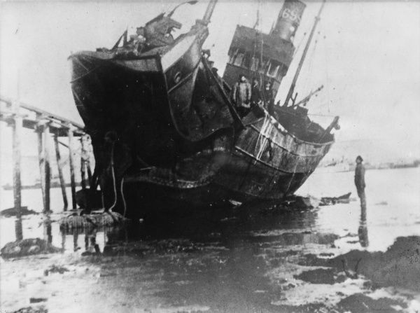 The effect of a mine explosion on a wrecked boat in Southend during World War I