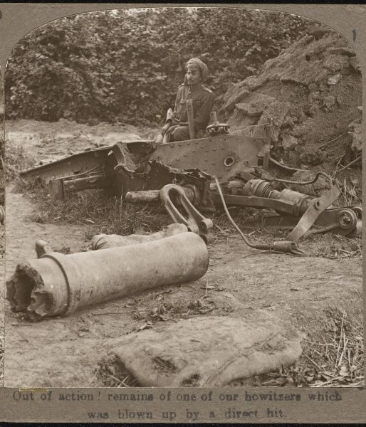 A Sikh soldier in the British army guards the remains of a howitzer which was blown up by a direct hit from German artillery