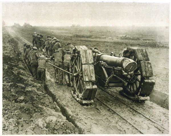 British soldiers move a heavy gun up to the front by manpower, hauling it through the mud Date: 1914 - 1918