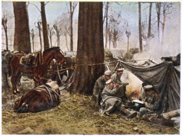 German soldiers rest in their camp in a Polish wood