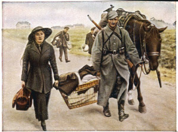 A Belgian refugee is assisted by a German soldier