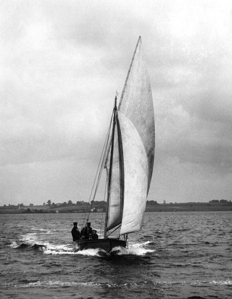 A small yacht on the River Stour, Essex, England. Date: 1930s
