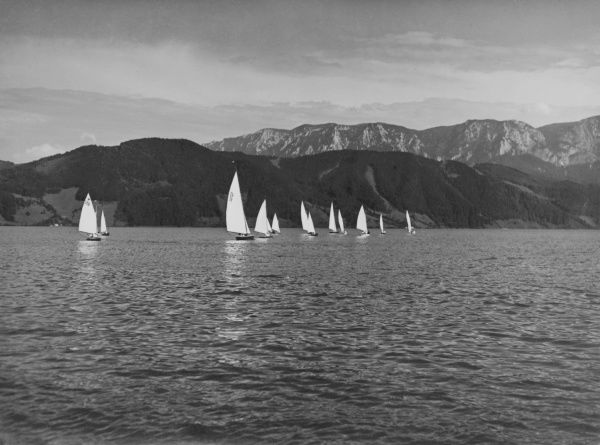 Yachting off a mountainous coast. Date: 1930s