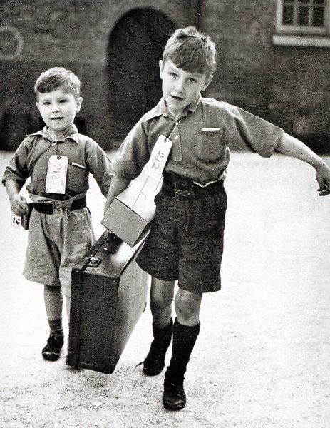 Two young evacuees with their belongings