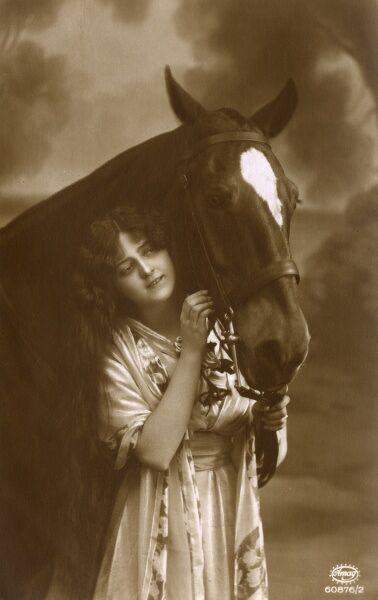 An attractive photographic postcard portrait of a young girl and her favourite horse. Date: circa 1906