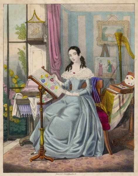 A woman sits on an upholstered chair by some french windows which open onto a garden. Contents of the room include a pedestal table, harp, framed landscape, birdcage & rug