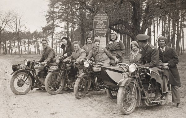 A group of young men and women out for a spin on their motor cycles, near the South Moravian town of Valtice (now in the Czech Republic). One of the men is wearing uniform