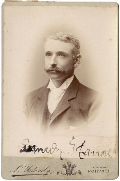 A handsome young Victorian man with short blond hair and a moustache in a head and shoulders portrait